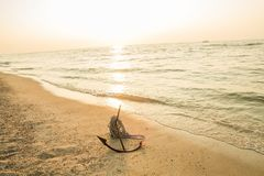 RUSTY ANCHOR WET BEACH SAND AND WHITE SEA WAVE FOAM Royalty Free Stock Photo