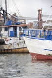 Rusty Anchored Fishing Ships Royalty Free Stock Image