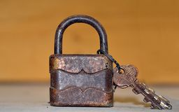 Antique padlock with keys. Rusty antique padlock with keys royalty free stock image