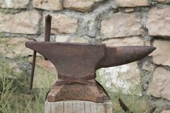 Rusty Anvil. An old rusty anvil sat on a wooden post Stock Image