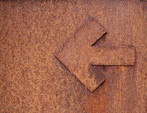 Rusty arrow. Grungy and rusty arrow showing you the way royalty free stock photography