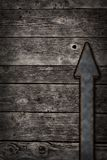 Rusty arrow on wooden background Royalty Free Stock Image