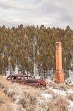 Rusty Auto and Brick Chimney Stock Photos