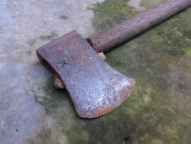 Rusty ax on the mossy floor stock photo