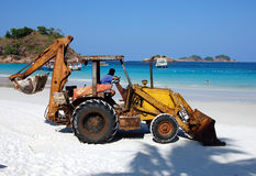 Rusty back hoe on white sand beach. Back hoe waiting to transport lugagein  Pulua Redang, Malaysia Royalty Free Stock Photography