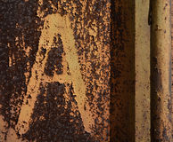Rusty background with letter A Stock Photography