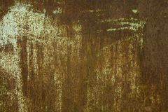 Rusty background. Rusty metallic surface covered with old cracked paint Stock Photos