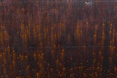 Rusty background. Old rusty metal sheet. Red rusted wall of the garage. Brown background. stock photo