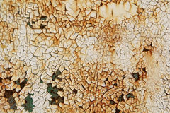Rusty background. Old Peeling Paint on Rusty Metal Grunge Background Royalty Free Stock Images