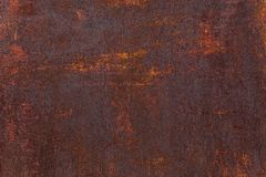 Rusty background. Old rusty metal sheet. Red rusted wall of the garage. Brown Grunge texture. royalty free stock photo
