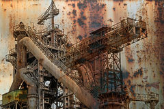 Rusty background with old steel furnace Stock Images