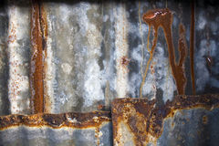 Rusty background. Rusty roof sheets with holes with room for text royalty free stock photo