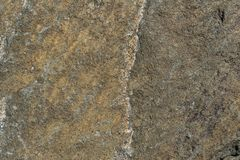 Rusty background. The surface of the marble with a brown tint. Grunge abstract stone. Surface royalty free stock photo
