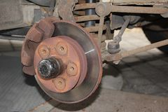 Brake calliper and disc of an old car Royalty Free Stock Image