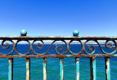 Rusty balustrade. On the sea front Stock Photos