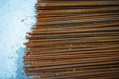 Rusty bar construction iron in bulk. Concrete stands on ground stock photos