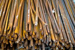 Rusty bar construction iron in bulk. Concrete stands on ground royalty free stock photography