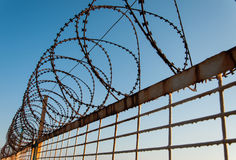 Rusty Barb Wire. Under the bright sun light with blue sky background Stock Photo