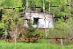 Rusty barbed wire. Blocking the passage to the building Stock Photo