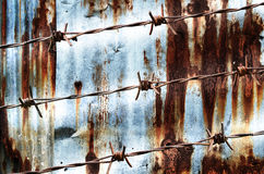 Rusty barbed wire design with on rust wall Stock Photo