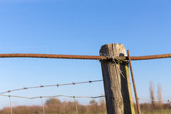 Rusty barbed wire old rough rusted metal posts Stock Images