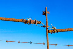 Rusty barbed wire old rough rusted metal posts Stock Image