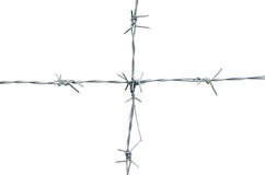 Rusty barbed wire vertically attached to the horizontal. Royalty Free Stock Photos