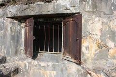 Rusty barred window. In stone wall on Sandy Hook, NJ Stock Photo