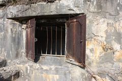 Rusty barred window Stock Photo