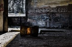 Rusty barrel and graffitis in industrial ruins. Old rusty barrel and graffitis in industrial ruins in Finland Stock Images