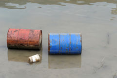 Rusty barrels in river Stock Photos