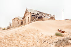 Rusty bathtub and ruins on a dune at Kolmanskop Stock Images