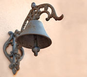 Rusty bell. Old rusty bell on a wall Royalty Free Stock Image