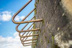 Rusty bent iron bars of an old bunker from close Stock Image