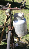 Rusty bicycle milkman and the Canister. Rusty bicycle milkman and the Milk can Royalty Free Stock Photography