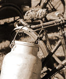 Rusty bicycle milkman and the Milk Canister. Old bicycle of milkman and the Milk Canister Royalty Free Stock Images