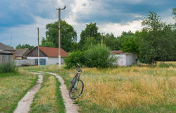 Rusty bicycle waiting for the master on the roadside in rural village in Ukraine Stock Images