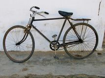 A rusty bicycle  in the  white city Ostuni Royalty Free Stock Image