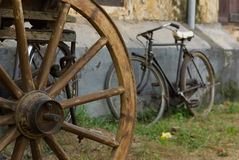 Rusty Bicycle and Wooden Wheel Royalty Free Stock Photography