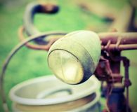 Rusty bike of a milkman with the front lights Royalty Free Stock Photography