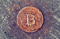 Rusty bitcoin coin royalty free stock photography