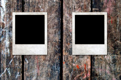 Rusty blank Photo frames on a wooden background Royalty Free Stock Photography