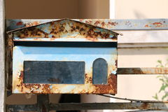Rusty Blue Postbox. An old rusty blue postbox in front of the house, waiting for the mail Stock Photo