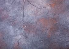 Rusty blue purple cement concrete stone texture with cracks. Rusty blue purple cement concrete stone texture background. Top view royalty free stock images
