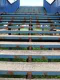 Rusty blue stairs. Rusty stairs on a railway station painted blue royalty free stock image