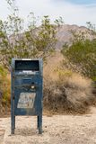 Rusty blue US mail box along Route 66. Mountains in the background royalty free stock photography