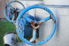 A rusty blue valve handle. Two rusty blue valve handles Royalty Free Stock Photos