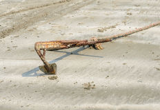 Rusty boat anchor on beach Royalty Free Stock Images