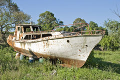 Rusty boat on the grass Stock Images