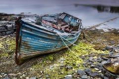 Rusty boat on Scottish beach Stock Photo